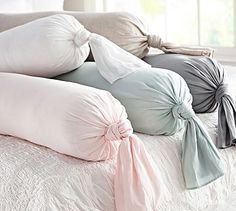 Linen Knot Bolster Pillow Cover #potterybarn -- cute! Try using t-shirt sheet pillow cases on the half round pillow.