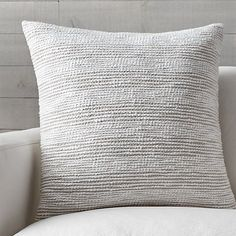 Thick and thin yarns are intermittently woven together to create soft, textural stripes. The Tess pillow adds dimension and neutral color, reversing to natural cotton chambray.Our decorative pillows include your choice of a plush feather-down or lofty down-alternative insert at no extra cost.