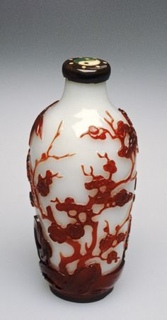 Chinese Glass Bottle with Bamboo and Flowers, 1st half 19th century.    opaque white glass, red overlay glass