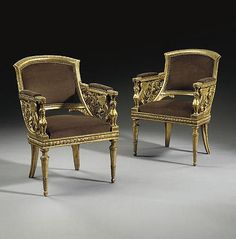 A PAIR OF ITALIAN GILTWOOD BERGERES <br />POSSIBLY TURIN, FIRST QUARTER 19TH CENTURY <br />Each incurved back with leaf-tip-carved crest and pierced sides carved with winged sphinxes continuing to foliate arabesque scrolls, covered with close-nailed chocolate brown sueded fabric, with drop-in seat, on a berried laurel-carved seatrail, on turned, tapering foliate-carved legs ending in ball feet, one stamped 'McD' twice and stamped '940' and '2511' (2)<br />