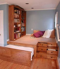 Love how much is packed into this tiny space - meditation platform, clothes storage, queen beed, and book storage!