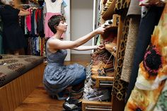 Susan Koger, co-founder and CCO of fashion website ModCloth, pulls out shelves full of shoes in the tricked-out closet at her home in San Francisco, CA Tuesday September 3, 2013. Photo: Michael Short, Special To The Chronicle