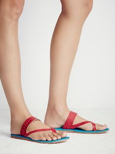Maui Slip On Sandal   Sandals with crisscross detailing and toe loop. Perforated design along strap.