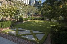 Golightly was asked to plan the garden spaces for this new construction French Normandy brick home with limestone detailing. By design, the development's communal green space, shallow house setbacks, and brick sidewalks with tree lined streets left little room in the front of the home for garden space but provided ample room in the back for a private oasis.