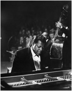 Canadian jazz pianist and composer Oscar Peterson. He released over 200 recordings, won 8 Grammys and played for over 60 years.