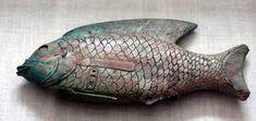 Carved wooden fish showing the cartouche of Intef VII (Nub-Kheper-Ra) from the 17th Dynasty c.1580-1550 BC. Cosmetic dishes are often in the form of the Nile fish Tilapia Nilotica, which is easily distinguished by its arrangement of fins as well as its general shape.  In some examples the dish had a hinged lid.