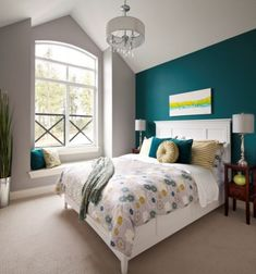 Teal Bedroom Ideas. A simple teal wall really pops in a gray and ...