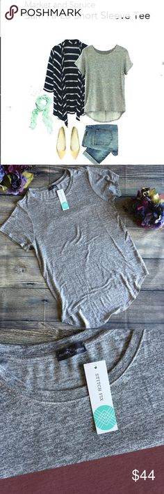 NWT Stitchfix Market & Spruce Sam Hi-low Knit Tee Meet Samantha. A favorite from Stitchfix brand Market & Spruce, she's super soft and oh so comfortable. Easy to dress up or down, she's a lightweight knit in a light grey color - the perfect neutral for all seasons and weather. Her hi-low hem style is great to pair with skinny capris, leggings, shorts, you name it. New with tags. Rayon/Poly/Spandex blend. Hand wash. Made in the USA. Size small (L3) Offers warmly received. Stitch Fix Market…