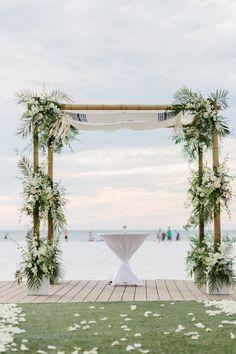 Beachfront wedding ceremony: http://www.stylemepretty.com/florida-weddings/clearwater/2017/03/30/classic-black-white-wedding/ Photography: K & K - http://www.kandkphotography.com/