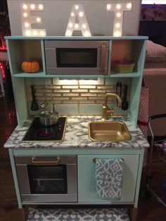 This kitchen set from IKEA turned out AMAZING. I painted cabinets and accessories. I used marble contact paper for the countertops and used peel and stick tile pieces for the backsplash! Ikea Kids Kitchen, Kitchen Sets For Kids, Diy Play Kitchen, Kitchen Backsplash Peel And Stick, Kitchen Flooring, Kitchen Countertops, Backsplash Ideas, Ikea Duktig, Painting Cabinets