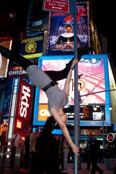 """Sindy Kay: """"No standing? Fine. But it doesn't say no extended butterflies! Polefit FTW — at Times Square NYC."""""""
