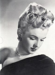Marilyn Monroe modelling the latest hairstyles for Twentieth Century Fox, 1947.