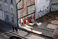 "place, two years later, new intervention. Under the direction of Collectif Etc, the vacant lot in Saint-Étienne (France) named ""Place du Géant"" has changed its shape again. These wooden benches have been designed by Collectif Parenthèse. Urban Furniture, Street Furniture, Urban Landscape, Landscape Design, Design D'espace Public, Urban Ideas, Urban Intervention, Public Realm, Public Art"