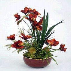 A beautiful floral arrangement that highlights the brightness and vibrancy of the tropicals, our orchid floral arrangement comes as shown attractively designed for the home.
