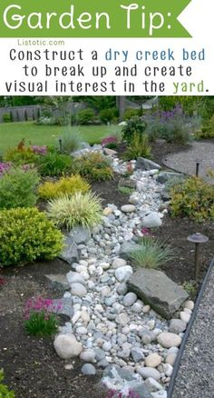To break up a large portion of the yard, consider a dry creek bed for added visual interest. It not only looks fabulous, but it's also great for landscape drainage and redirecting rain water on a slope. And, it very low maintenance!