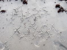 words in sand at cocoa beach