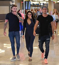 Third wheel: Gaz walked with on/off couple Aaron Chalmers and Marnie Simpson through arrivals