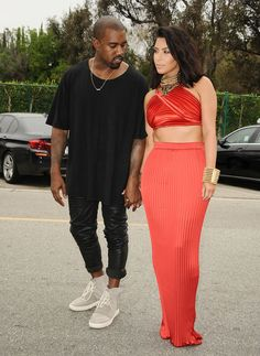 There has been no shortage of cute red carpet moments and PDA-filled appearances throughout their relationship, but one thing that has stuck out about Kanye's love of (and fascination with) Kim is how he always seems to be checking her out. See 25 times he couldn't keep his eyes off of Kim!