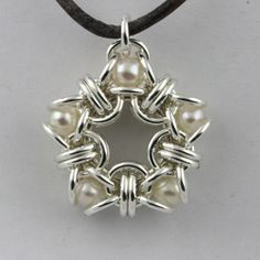 Pearl Star Chainmaille Pendant... Tons of other cool designs on this site....