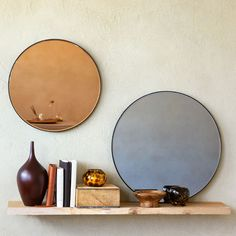 Image of the product COPPER-TONED ROUND GLASS MIRROR