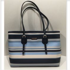 Dana Buchman Handbag. Dana Buchman Handbag.  Cute striped bag in vinyl for easy cleaning. Back exterior has 1 slide in pocket. Interior has 2 main compartments 1 large zippered 2 slide in and one side zippered compartment. Loads of space for your things!! Snap closure. Measures approx 13 wide 9 1/2 tall 5 1/2 deep Bags