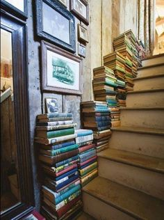 Books stacked up the stairs