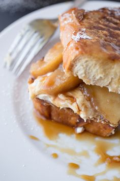 """Caramel Apple """"Stacked"""" French Toast with Brown Sugar-Caramelized Orchard Apples and Spiced Cream Cheese, drizzled with Warm, Maple-Caramel Syrup."""
