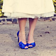 Standout Shoes  A fun trend has been to wear brightly coloured wedding shoes. If you are wearing a shorter style wedding gown then your shoes will be a big focal point of your look, so why not experiment with some brightly coloured choices and tie your shoes into your colour scheme.