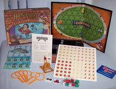 Various other tiles reveal bonuses and penalties. When a player wants to score with a quaffle, he loads a quaffle ball into a miniature catapult and tries to launch it through hoop. That scores 10 points. Quidditch Game, Harry Potter Quidditch, Harry Potter Props, Harry Potter Theme, Dice Games, Fun Games, Mystery Parties, Battle Games, Vintage Board Games