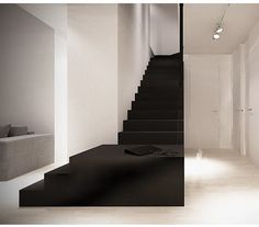 White interior with a bold black staircase. Architect: unknown.