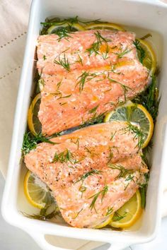 Our baked salmon recipe with lemon and dill takes less than 30 minutes and makes the most perfect tender salmon. By gently baking salmon in a small amount of liquid, the fish stays moist and tender. It practically melts in your mouth. Baked Salmon Lemon, Oven Baked Salmon, Baked Salmon Recipes, Baked Fish, Baked Salmon Filets, Salmon Fillets, Dill Recipes, Seafood Recipes, Frozen Salmon