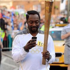 The Voice judge Will.am carried the Olympic Torch on Monday. The Black Eyed Peas star was cheered on by thousands of people as he ran through Taunton carrying the flame. Over 9000, Olympic Flame, Caption Contest, 9 Gag, Stop Caring, American Rappers, Latest News Headlines, Black Eyed Peas, Laughter