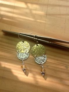 Silver and brass, hand etched and forged, dangling a gleaming citrine gem.  Www.ArtisticRite.etsy.com