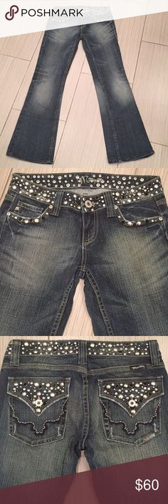 Miss Me Bootcut Studded Jeans JP42888 Sz 26/31 The is a beautiful pair of medium blue ornate pants with  silver studded and black rhinestone motif by Miss Me.  Made for the Fashionista of Premium denim jeans!  Very high quality item done is a chic waistline design.  Don't pass up this awesome pair  jeans.  Listed as New With No Tag(s), so purchase with confidence. Miss Me Jeans Boot Cut