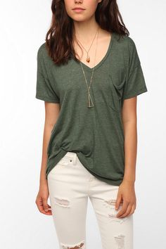 Truly Madly Deeply V-Neck Pocket Tee - $24 at Urban Outfitters. This whole outfit actually looks really great together. I can totally see myself wearing this so much during the fall and winter with a leather jacket and some short boots.