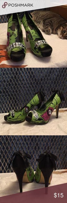 Iron Fist Zombie Platform Heels Awesome zombie peep toe Platform heels. Worn maybe a total of 6 hours.  These run small. I'm usually a us size 10 but these are 11s. Iron Fist Shoes Heels