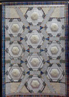 Ten Tiny Teddies by Birgitta Debenham. Tiny teddy bears were tucked into fluffy fur at the center of each block. Contemporary Quilts exhibit.  The Festival of Quilts 2015.  Posted at the Bernina Blog.