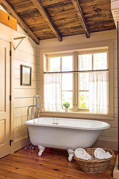 Keeping the shiplap walls a subtle shade (Manchester Tan by Benjamin Moore) doesn't draw attention away from the beautiful millwork and natural logs.