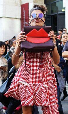 Giovanna Battaglia in a Simone Rocha dress, Dita sunglasses, and with a Sara Battaglia bag