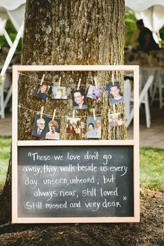 chalkboard wedding signs to honor deceased loved ones at wedding with their photos / http://www.deerpearlflowers.com/wedding-photo-display-ideas/