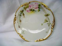 We are offering you four fabulous hand painted Limoges plates all for one price. Each plate is hand painted with lovely pink blooming roses and then gold gilt around the outside periphery of each Vintage Plates, Vintage China, Glass Onion, Hand Painted Plates, Blooming Rose, Fine China, Body Care, Tea Time, Cups