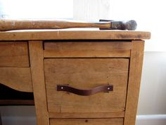Make drawer pulls from an old leather belt.  I have a dresser that has ugly handles but they are an odd size that I cannot find, so this might be a good solution!