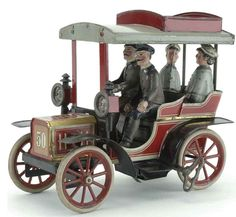 Antique four passenger sedan. all tin.