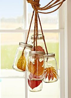 Rope in decor: Replicate a chandelier with leaves instead of lights. Drill a 1⁄4-inch hole in each canning jar lid. Pull a separate piece of rope through each hole, then tie a knot under each lid. Place single leaves in jars, and tightly secure lids. Tie rope pieces together and hang from a heavy-duty ceiling hook.