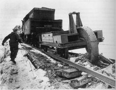 Railroad destroyer 'Schienenwolf' at work as the Germans retreat on the Eastern Front, winter 1943.
