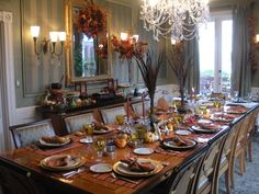 Thanksgiving table with no tablecloth? It works here with the beautiful placemats. I always worry about the finish on the table with hot foods though.