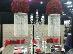 Red rose with crystal centerpiece and lounge furniture! #weddings #events #decor