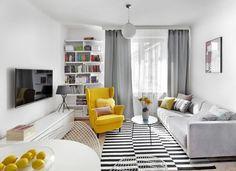 <p>Mały salon urządzono w stylu lat 60. Biało-czarna aranżacja wnętrza ocieplona szarością i ożywiona mocnymi, żółtymi dodatkami, jest ciepła i przytulna. Dzięki pomysłowym rozwiązaniom wnętrze wydaje się większe niż w rzeczywistości.</p>