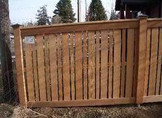 cedar fence design... alternating vertical board widths ...