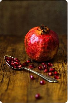 still life photography | Pomegranate fruit and spoon on rustic wood table | Food photo